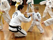 Master Rhee explains technique to a Junior student
